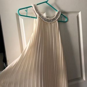 White pleated dress with pearls and diamonds